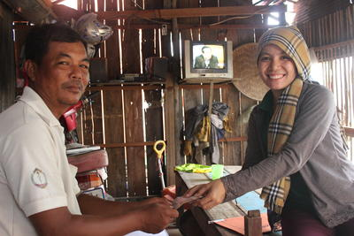 Projects Abroad Micro-finance volunteer visits the home of a beneficiary in Phnom Penh, Cambodia
