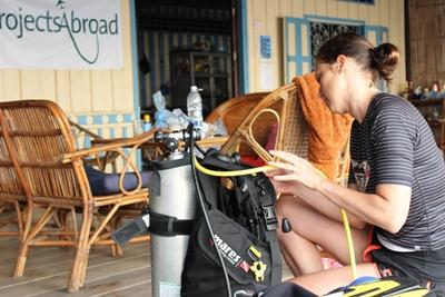 Nesrin Wilfred, from Germany, prepared the diving equipment to diving in the morning at Koh Sdach island Conservation project