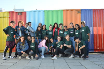 High School Special volunteers in front of a colourful container in a township in South Africa