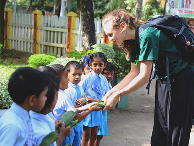 A medical volunteer in Sri Lanka is welcomed into a local school