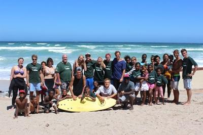 Volunteers and children at surfing project in South Africa