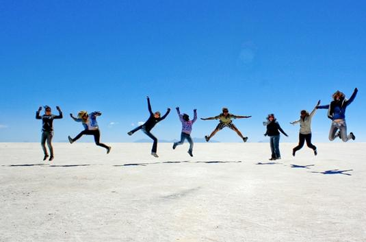 Volunteers having fun on sand dunes in Bolivia, South America