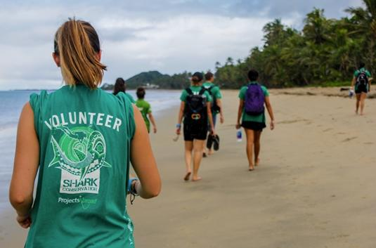 Projects Abroad Shark Conservation volunteers walk along the beach in Pacific Harbor towards the point where they will start with the beach cleanup.