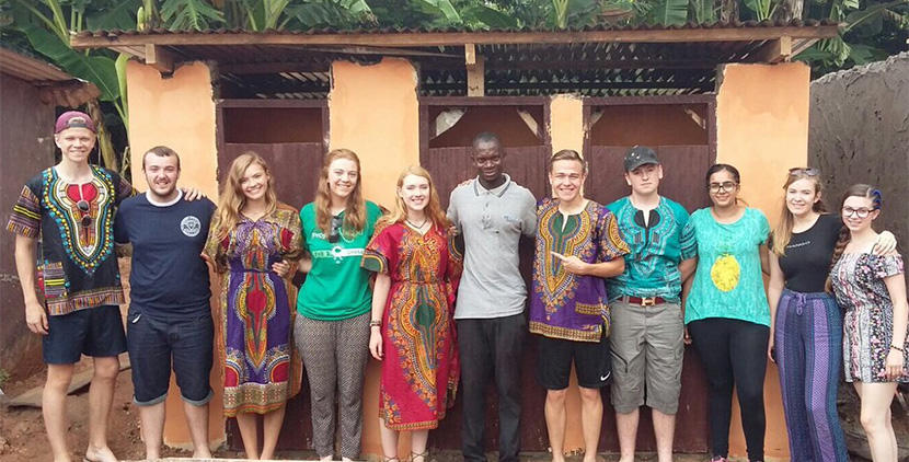 The group from Ackworth School posing for a photo in front of the finished toilet block in Ghana