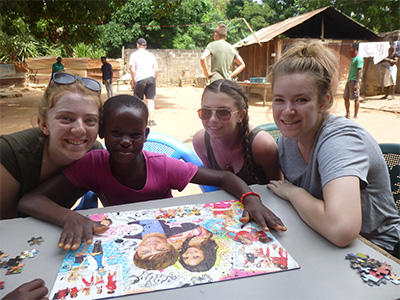 The girls from the group completed a jigsaw with one of the local children