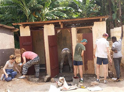 The group working tirelessly to finish the build of the new toilet block