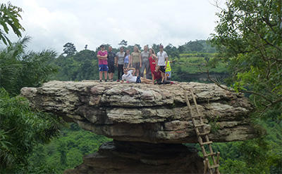 The group pose for a photo during a hike at the Kakum National Park