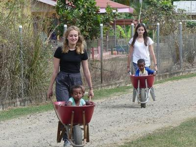 Kids in wheelbarrows