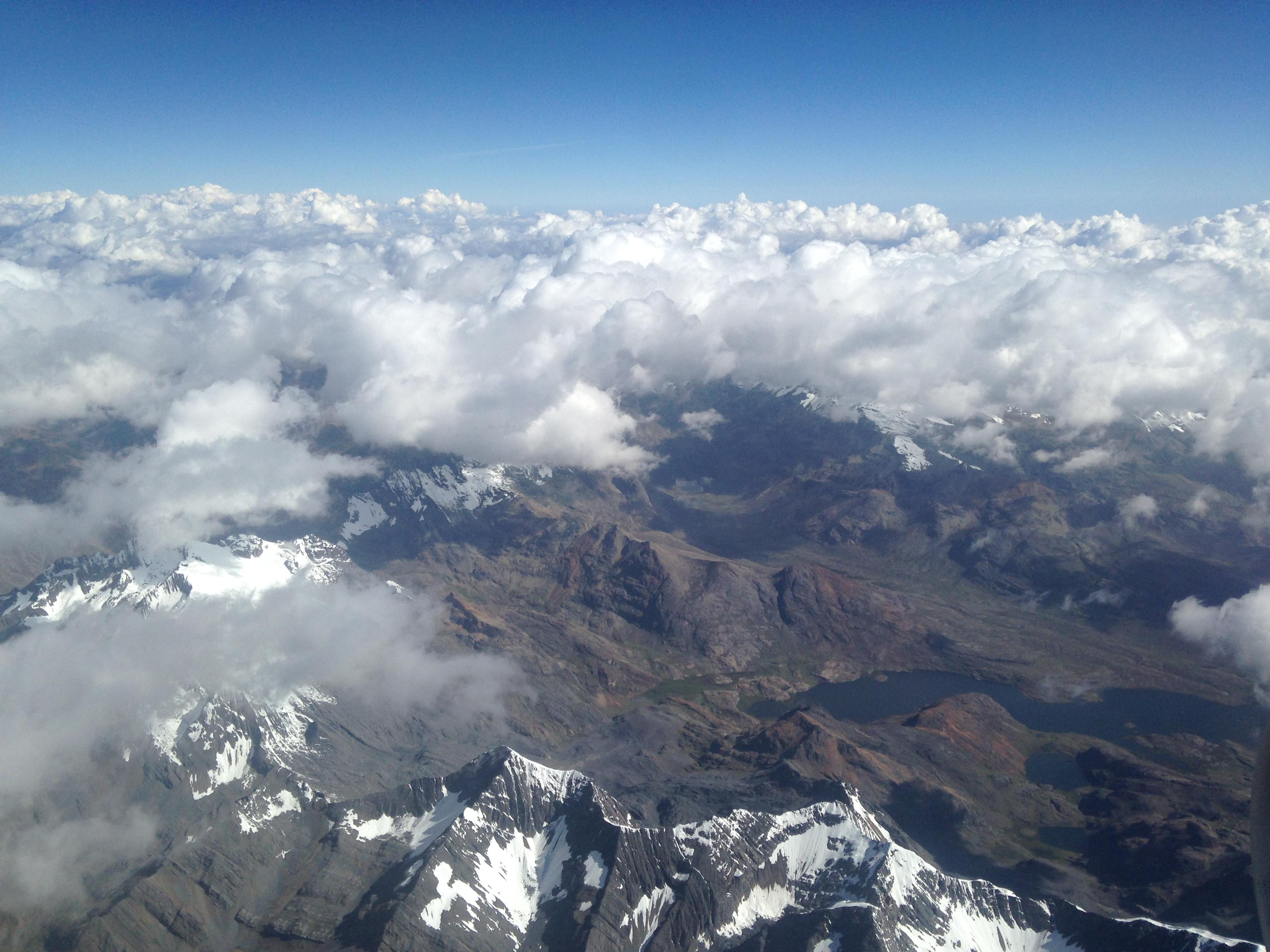 A view from the plane of the snow-capped Andes Mountains