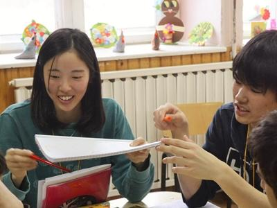 Japanese Students from the KLAS Group teaching English to the Romanian children