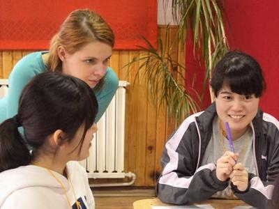 Two girls from the KLAS Group teaching English to the Romanian children