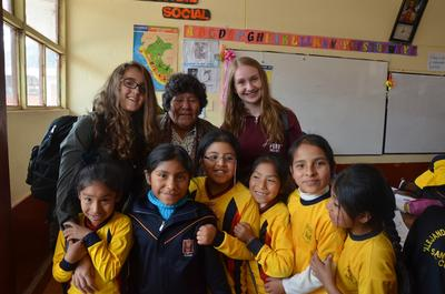 High School volunteers together with the children and teacher in Cusco