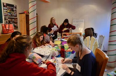 High School volunteers creating resources which they can use to teach children