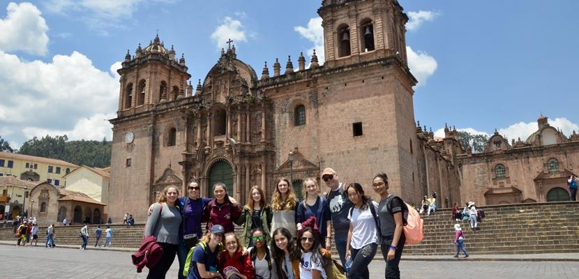 High School Special volunteers take a group photo outside a cathedral in Peru