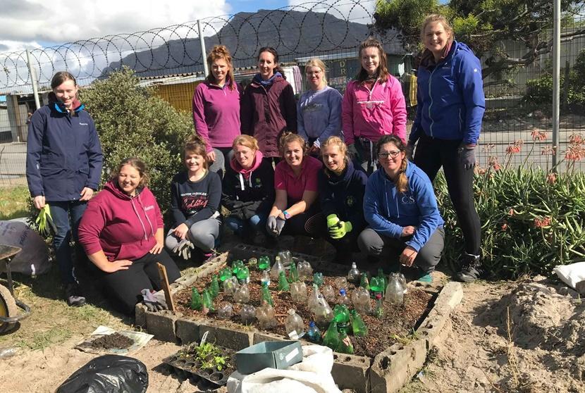 Group photo with a garden