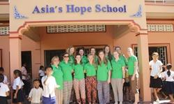 Projects Abroad Care and Community volunteers from Anglia Girl Guides group in the UK outside their school placement in Cambodia
