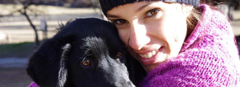 Volunteer cares for a dog in an Argentinian dog shelter