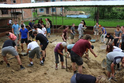 Projects Abroad Disaster Relief volunteers work to dig the foundations for a new school in Kathmandu, Nepal