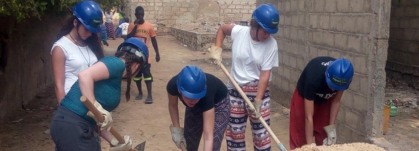 HSS volunteers work at a construction site in Senegal