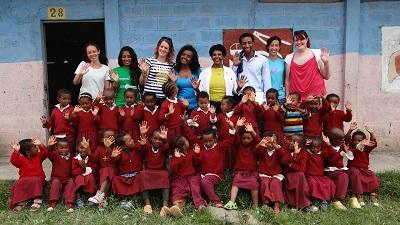 A group photo of volunteers, staff, and children in Ethiopia