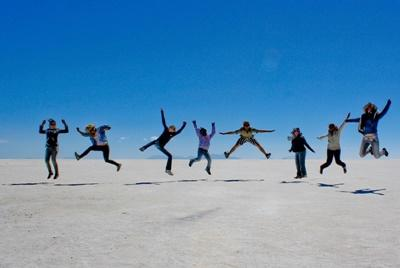 Volunteers having fun on salt flats in Bolivia, South America