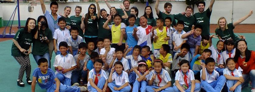 A group of volunteers and children at a school in China