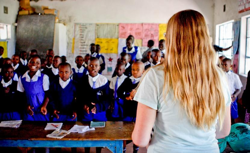 A female volunteer in a class at a teaching project in Kenya