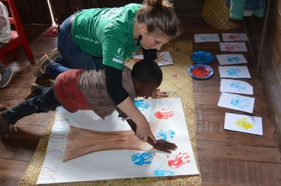 A Care volunteer working on an art project with a child in Madagascar