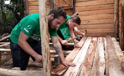 Volunteers in Madagascar building a house during a community day