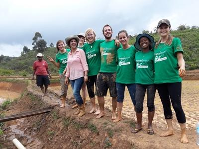 Volunteers after planting rice during a community day in Madagascar