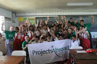 A group of Projects Abroad Teaching volunteers with students at their placement school in Apia, Samoa