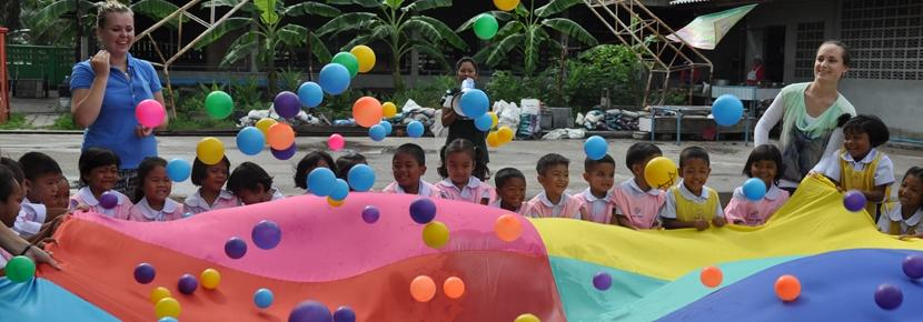 Dutch volunteers playing with children at care project Thailand