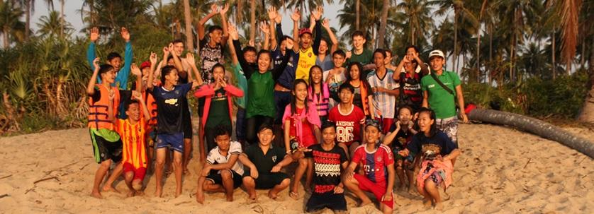 Teenage group from the local community learn how to swim and snorkel in Cambodia