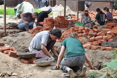 Projects Abroad Disaster Relief volunteers lay bricks for a new classroom at Sunrise School, Kathmandu, Nepal