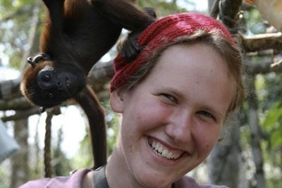 Female volunteer with a monkey in the conservation project in Peru, South America