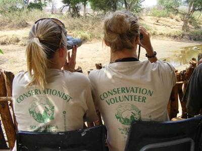 A group of conservation volunteers undertaking a bird watching activity