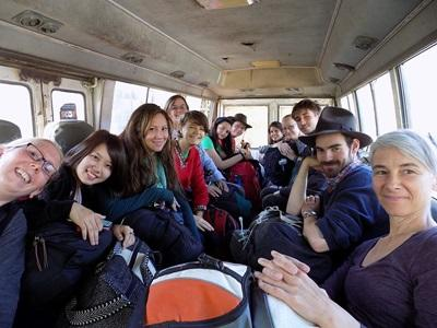 Inca volunteers ride a bus to the site