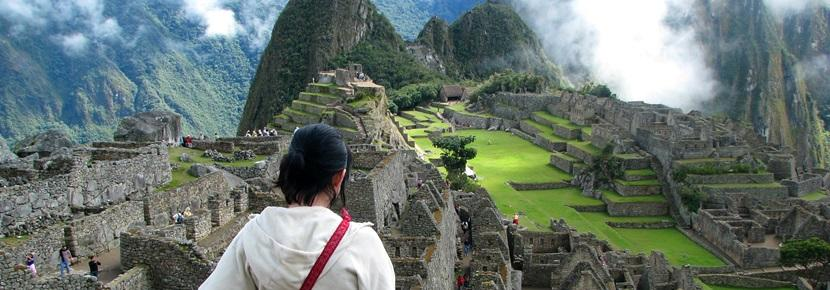 Volunteer overlooking the Machu Picchu in Peru, South America