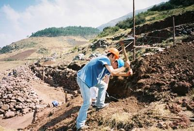 Male volunteers working at Inca site in Peru
