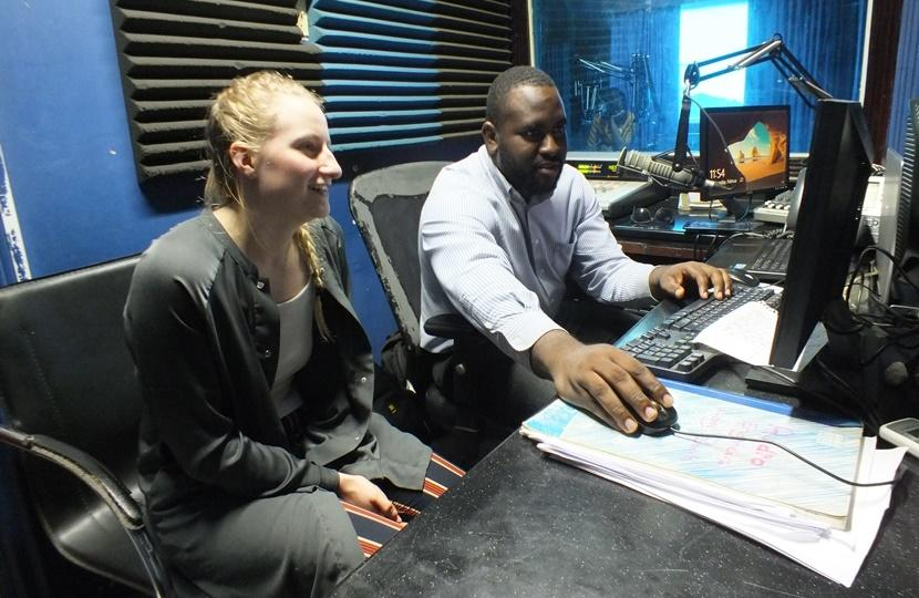 Volunteer learning the different aspects of working in radio