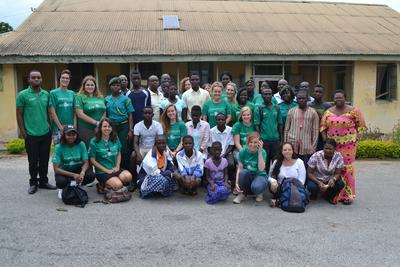 Group photograph of Projects Abroad Human Rights volunteers and staff with children rescued from child trafficking, immigration officers and staff of the informal education unit of the Winneba municipality