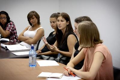 A group debates about women's rights at the Human Rights placement overseas.