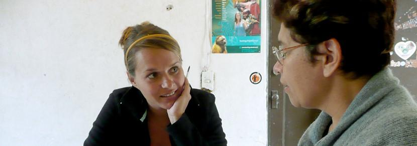 A volunteer enjoys her language lesson during her group trip abroad.