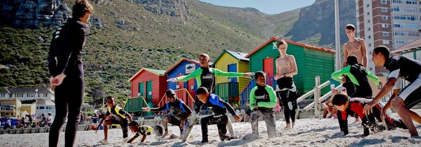 Your group could help children to learn to surf through the Surfing Project in South Africa.