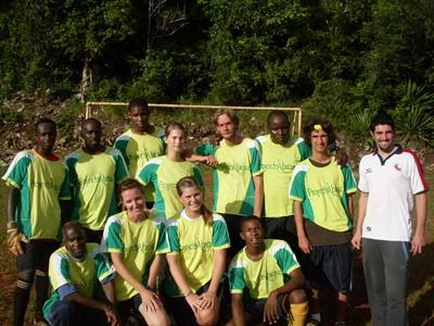 A group dress up in their football team uniform and pose for a photograph.