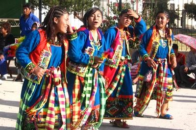 A group of girls dancing at a local festival in Bolivia