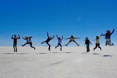 Volunteers having fun on the salt flats in Bolivia, South America