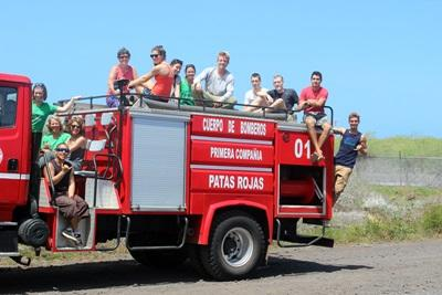 Projects Abroad conservation volunteers plant garden at Fire Station in Galapagos, Ecuador