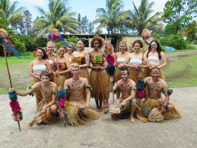 A group of volunteers are dressed up as Fijians for some cultural celebrations