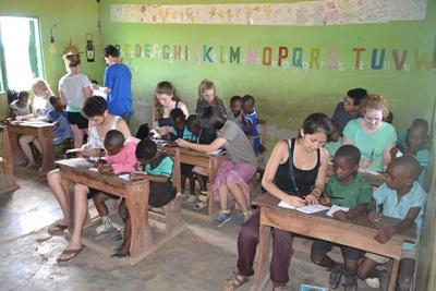 Projects Abroad Care volunteers do arts and crafts activities with children at a local school in Ghana